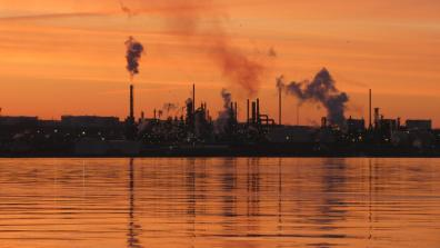 Oil Refinery at Dawn by Iguanasan is licensed under CC BY-NC-ND 2.0